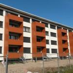 Wohnbau Wörth, Stahl-Vorstatzbalkone, Verkleidung mit Trespa-Platten